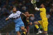 Francesco Acerbi of SS Lazio competes for the ball with Cristian Molinaro and Marco Sportiello of Frosinone Calcio in action during the serie A match between SS Lazio and Frosinone Calcio at Stadio Olimpico on September 2, 2018 in Rome, Italy.