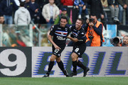 Giampaolo Pazzini (R) and Antonio Cassano of UC Sampdoria celebrate Pazzini's 40th minute strike and opening goal during the Serie A match between SS Lazio and UC Sampdoria at Stadio Olimpico on October 18, 2009 in Rome, Italy.