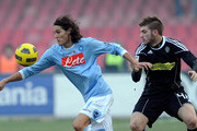 Edinson Cavani of Napoli and Davide Santon of Cesena compete during the Serie A match between SSC Napoli and AC Cesena at Stadio San Paolo on February 6, 2011 in Naples, Italy.