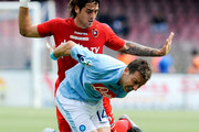 Hugo Campagnaro (front) of Napoli and Joaquin Larrivey of Cagliari in action during the Serie A match between SSC Napoli and Cagliari Calcio at Stadio San Paolo on April 25, 2010 in Naples, Italy.