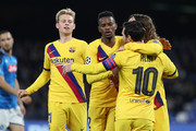 Nelson Semedo, Antoine Griezmann and Lionel Messi of FC Barcelona celebrate the 1-1 goal scored by Antoine Griezmann during the UEFA Champions League round of 16 first leg match between SSC Napoli and FC Barcelona at Stadio San Paolo on February 25, 2020 in Naples, Italy.