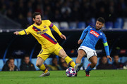 Lionel Messi of FC Barcelona wins the ball from Lorenzo Insigne of SSC Napoli during the UEFA Champions League round of 16 first leg match between SSC Napoli and FC Barcelona at Stadio San Paolo on February 25, 2020 in Naples, Italy.