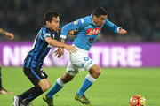 Napoli's player Marques Loureiro Allan vies with FC Internazionale Milano player Yuto Nagatomo during the Serie A match between SSC Napoli and FC Internazionale Milano at Stadio San Paolo on November 30, 2015 in Naples, Italy.