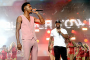 "Trey Songz (L) and Curtis ""50 Cent"" Jackson perform onstage at STARZ Madison Square Garden ""Power"" Season 6 Red Carpet Premiere, Concert, and Party on August 20, 2019 in New York City."