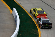Matt Kenseth, driver of the #20 Dollar General Toyota, leads Dale Earnhardt Jr., driver of the #88 Diet Mountain Dew Chevrolet, during the NASCAR Sprint Cup Series STP 500 at Martinsville Speedway on March 30, 2014 in Martinsville, Virginia.