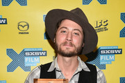 Director Turner Ross poses with the award for during the SXSW FIlm Awards at the 2015 SXSW Music, FIlm + Interactive Festival at the Paramount Theatre on March 17, 2015 in Austin, Texas.