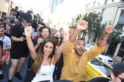 """Actor Hale Appleman, actress Summer Bishil and actor Arjun Gupta of """"The Magicians"""" Surprise Fans on the Karaoke Bus at San Diego Comic Con on July 21, 2017 in San Diego, California."""