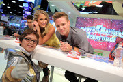 Actors Ciara Hanna and Cameron Jebo pose with a fan in his Silver Ranger costume during the Comic-Con Power Rangers cast signing at the Nickelodeon booth during San Diego Comic-Con International 2014 at San Diego Convention Center on July 25, 2014 in San Diego, California.