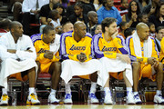 (L-R) Kobe Bryant #24, Ron Artest #15, Lamar Odom #7, Pau Gasol #16 and Derek Fisher #2 of the Los Angeles Lakers watch from the bench during a preseason game against the Sacramento Kings at the Thomas & Mack Center October 13, 2010 in Las Vegas, Nevada. The Lakers won 98-95. NOTE TO USER: User expressly acknowledges and agrees that, by downloading and/or using this Photograph, user is consenting to the terms and conditions of the Getty Images License Agreement.