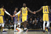 LeBron James #23 of the Los Angeles Lakers is congratulated by his teammate Brandon Ingram #14 and Josh Hart #3 after scoring a basket and getting fouled against Sacramento Kings during the first half at Staples Center on October 4, 2018 in Los Angeles, California. NOTE TO USER: User expressly acknowledges and agrees that, by downloading and or using this photograph, User is consenting to the terms and conditions of the Getty Images License Agreement.