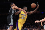 Vince Carter #15 of the Sacramento Kings defends against a pass to Julius Randle #30 of the Los Angeles Lakers during the second half of a game at Staples Center on January 9, 2018 in Los Angeles, California.   NOTE TO USER: User expressly acknowledges and agrees that, by downloading and or using this photograph, User is consenting to the terms and conditions of the Getty Images License Agreement.