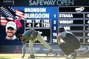 Ryan Moore and Andres Gonzales prepare to putt after Bronson Burgoon made par on the ninth hole during the second round of the Safeway Open at the North Course of the Silverado Resort and Spa on October 5, 2018 in Napa, California.