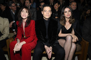 (EDITORIAL USE ONLY) Charlotte Gainsbourg, Rami Malek and Ana de Armas attend the Saint Laurent show as part of the Paris Fashion Week Womenswear Fall/Winter 2020/2021 on February 25, 2020 in Paris, France.