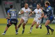 Olly Woodburn of  Exeter Chiefs looks for a way past Danny Cipriani and Johnny Leota of Sale Sharks during the Aviva Premiership match between Sale Sharks and Exeter Chiefs at the A J Bell Stadium on February 13, 2016 in Salford, England