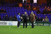 Kingsley Jones,(C) the Sale Sharks director of rugby looks dejected as he talks to coach Jason Robinson (L) and club owner Brian Kennedy after the abandonment of the Guinness Premiership match between Sale Sharks and London Wasps at Edgeley Park on November 27, 2009 in Stockport, England.