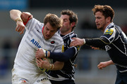 Chris Wyles (L) of Saracens is tackled by Danny Cipriani (R) and Nick MacLeod of Sale during the LV= Cup Semi Final match between Sale Sharks and Saracens at the Salford City Stadium on March 10, 2013 in Salford, England.