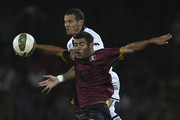 Djamel Mesbah (back) of Parma FC is challenged by Denilson Gabbionetta (front) of US Salernitana during the pre-season friendly match between US Salernitana and Parma FC at Stadio Diceu on August 4, 2014 in Eboli, Italy.