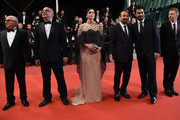 """(FromL) Iranian actor Farid Sajjadihosseini, Iranian actor Babak Karimi, Iranian actress Taraneh Alidoosti, Iranian director Asghar Farhadi, Iranian actor Shahab Hosseini and French producer and distributor Alexandre Mallet-Guy pose as they arrive on May 21, 2016 for the screening of the film """"The Salesman (Forushande)"""" at the 69th Cannes Film Festival in Cannes, southern France.  / AFP / ANNE-CHRISTINE POUJOULAT"""