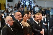 """(FromL) Iranian actor Farid Sajjadihosseini, Iranian actor Babak Karimi, Iranian actress Taraneh Alidoosti, Iranian actor Shahab Hosseini, Iranian director Asghar Farhadi and French producer and distributor Alexandre Mallet-Guy pose as they arrive on May 21, 2016 for the screening of the film """"The Salesman (Forushande)"""" at the 69th Cannes Film Festival in Cannes, southern France.  / AFP / ALBERTO PIZZOLI"""