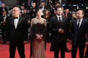 """Actor Babak Karimi, actress Taraneh Alidoosti, actor Shahab Hosseini and director Asghar Farhadi attend """"The Salesman (Forushande)"""" Premiere during the 69th annual Cannes Film Festival at the Palais des Festivals on May 21, 2016 in Cannes, France."""