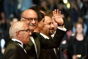 """(FromL) Iranian actor Farid Sajjadihosseini, Iranian actor Babak Karimi, Iranian actress Taraneh Alidoosti and Iranian director Asghar Farhadi pose as they arrive on May 21, 2016 for the screening of the film """"The Salesman (Forushande)"""" at the 69th Cannes Film Festival in Cannes, southern France.  / AFP / ALBERTO PIZZOLI"""