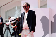 """Director Luca Guadagnino is seen at red carpet of """"Salvatore – Shoemaker of Dreams"""" on September 06, 2020 in Venice, Italy."""