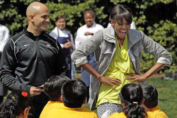 Sam Kass Michelle Obama Hosts Students at Garden Kitchen Event