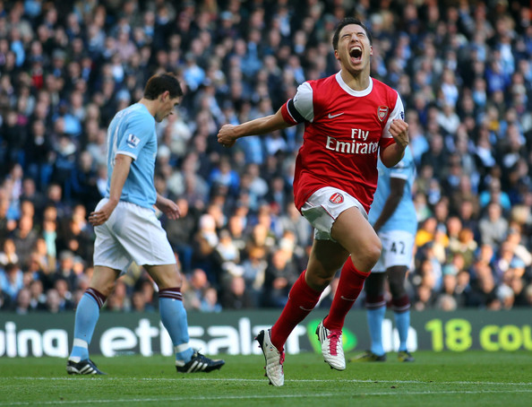 Samir Nasri Samir Nasri of Arsenal celebrates his goal during the Barclays Premier League match between Manchester City and Arsenal at City of Manchester Stadium on October 24, 2010 in Manchester, England.