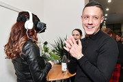 Meghan McDermott and actor Theo Rossi experience Samsung Gear VR during a party to celebrate the productÕs two year anniversary on December 11, 2017 in New York City.