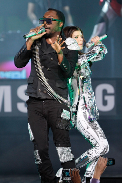 Singers Will.i.am and Fergie of the Black Eyed Peas perform live at the Samsung Times Square Concert with THE BLACK EYED PEAS at Times Square on March 10, 2010 in New York City.