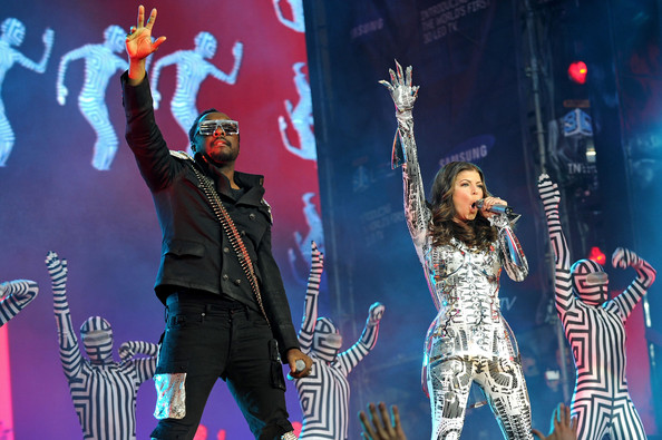 Will.i.am and Fergie of the Black Eyed Peas perform at the Samsung Times Square Concert with THE BLACK EYED PEAS at Times Square on March 10, 2010 in New York City.