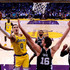 Pau Gasol Photos - Kyle Kuzma #0 of the Los Angeles Lakers scores on a layup past Pau Gasol #16 of the San Antonio Spurs during a 143-142 Laker loss at Staples Center on October 22, 2018 in Los Angeles, California. - San Antonio Spurs v Los Angeles Lakers