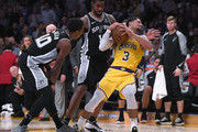 Josh Hart #3 of the Los Angeles Lakers controls a rebound from LaMarcus Aldridge #12 and DeMar DeRozan #10 of the San Antonio Spurs during an overtime 143-142 Laker loss at Staples Center on October 22, 2018 in Los Angeles, California.