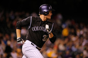 Justin Morneau #33 of the Colorado Rockies hits a triple against the San Diego Padres at Coors Field on September 18, 2015 in Denver, Colorado. The Rockies defeated the Padres 7-4.