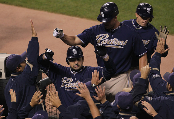 Adrian Gonzalez #23 of the San Diego Padres is congratulated by teammates after hitting a three run home run during the third inning against the San Francisco Giants October 1, 2010 in San Francisco, California.