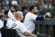 Ryon Healy #27 of the Seattle Mariners, left, Nelson Cruz #23 and Kyle Seager #15 sit at the bar in the fifth inning as they trail the San Diego Padres at Safeco Field on September 12, 2018 in Seattle, Washington.