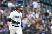 Nelson Cruz #23 of the Seattle Mariners watches his home run, also his 1,000th RBI, sail out of the field in the fifth inning against the San Diego Padres at Safeco Field on September 12, 2018 in Seattle, Washington.