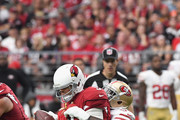 Quarterback Carson Palmer #3 of the Arizona Cardinals is sacked by outside linebacker Eli Harold #57 of the San Francisco 49ers during the second half of the NFL game at the University of Phoenix Stadium on October 1, 2017 in Glendale, Arizona.