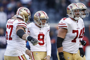 Kicker Robbie Gould #9 of the San Francisco 49ers celebrates with teammates, including  Joe Staley #74, after scoring the game winning field goal against the Chicago Bears in the fourth quarter at Soldier Field on December 3, 2017 in Chicago, Illinois.  The San Francisco 49ers defeated the Chicago Bears 15-14.