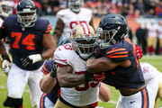 Ka'Deem Carey #25 of the Chicago Bears carries the football against  NaVorro Bowman #53 of the San Francisco 49ers for 4 yards into the endzone, resulting in a touchdown in the fourth quarter at Soldier Field on December 6, 2015 in Chicago, Illinois.