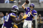 Kirk Cousins #8 of the Minnesota Vikings passes the ball to Dalvin Cook #33 in the first quarter of the game against the San Francisco 49ers at U.S. Bank Stadium on September 9, 2018 in Minneapolis, Minnesota.