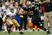 Jimmy Graham #80 of the New Orleans Saints pulls in this reception against Donte Whitner #31 of the San Francisco 49ers at Mercedes-Benz Superdome on November 17, 2013 in New Orleans, Louisiana.