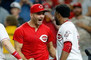 Joey Votto #19 of the Cincinnati Reds congratulates Phillip Ervin #27 after hitting a walk off home run during the 11th inning of the game against the San Francisco Giants at Great American Ball Park on August 17, 2018 in Cincinnati, Ohio. Cincinnati defeated San Francisco 2-1 in 11 innings.