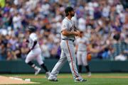 Starting pitcher Madison Bumgarner #40 of the San Francisco Giants walks around the mound after giving up a two-run home run to Trevor Story #27 of the Colorado Rockies during the first inning at Coors Field on September 3, 2018 in Denver, Colorado.