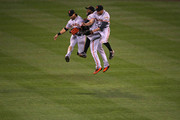 (L-R) Angel Pagan #16, Denard Span #2 and Hunter Pence #8 of the San Francisco Giants celebrate their 7-2 victory over the Colorado Rockies at Coors Field on April 12, 2016 in Denver, Colorado.