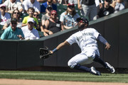 Left fielder Denard Span #4 of the Seattle Mariners cannot get to a ball off the bat of Brandon Crawford #35 of the San Francisco Giants that scored Chase d'Arnaud during the seventh inning of a game at Safeco Field on July 25, 2018 in Seattle, Washington. The Mariners won the game 3-2.