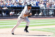 Madison Bumgarner #40 of the San Francisco Giants drives in a run with a double in the fourth inning against the New York Mets during their game at Citi Field on August 23, 2018 in New York City.