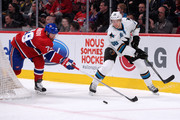 Melker Karlsson #68 of the San Jose Sharks passes the puck in front of Andrei Markov #79 of the Montreal Canadiens during the NHL game at the Bell Centre on March 21, 2015 in Montreal, Quebec, Canada.