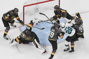Jon Merrill #15 and Colin Miller #6 of the Vegas Golden Knights scramble behind Marc-Andre Fleury #29 of the Golden Knights to stop a shot by Timo Meier #28 of the San Jose Sharks from crossing the goal line as Reilly Smith #19 and William Karlsson #71 of the Golden Knights defend in the first overtime period of Game Six of the Western Conference First Round during the 2019 NHL Stanley Cup Playoffs at T-Mobile Arena on April 21, 2019 in Las Vegas, Nevada. The Sharks defeated the Golden Knights 2-1 in double overtime to even the series at 3-3.