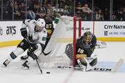 Mikkel Boedker #89 of the San Jose Sharks skates with the puck against Shea Theodore #27 and Marc-Andre Fleury #29 of the Vegas Golden Knights in the third period of Game Five of the Western Conference Second Round during the 2018 NHL Stanley Cup Playoffs at T-Mobile Arena on May 4, 2018 in Las Vegas, Nevada. The Golden Knights won 5-3.